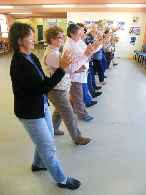 The members of a peer-led tai chi group that meets at the Octagon Seniors Club believe tai chi is...