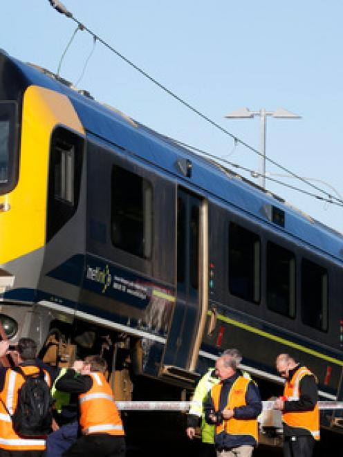 The Metlink Matangi train is inspecting by Transrail staff after crashing over a barrier at the...