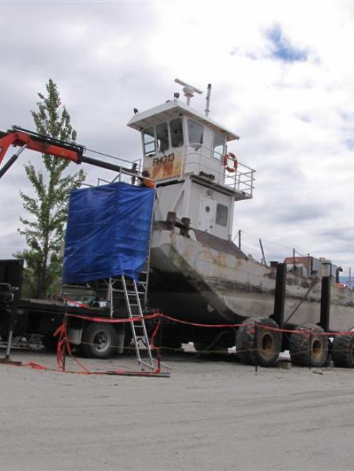 The Minaret Station barge's pusher boat this week at Waterfall Creek,  where it is undergoing...
