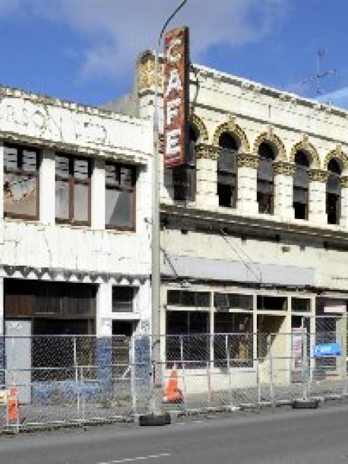 The N. & E.S. Paterson and Barrons buildings, demolition of which  is  set to resume soon, after...