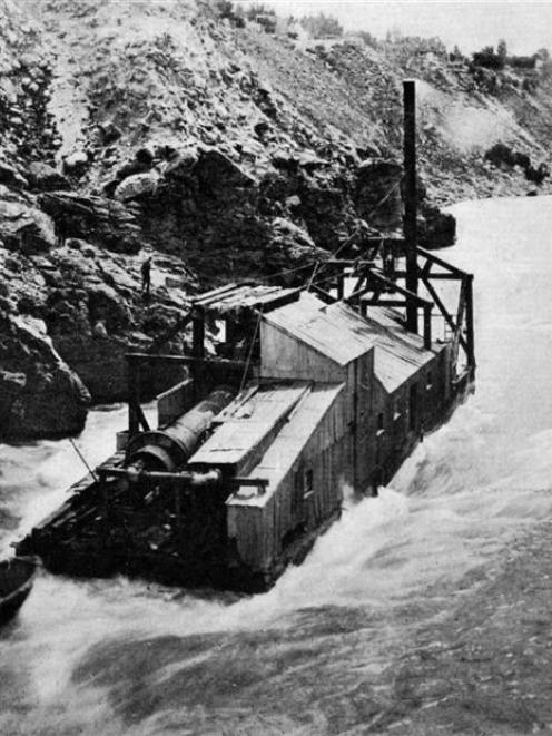 The new Hartley and Riley dredge entering the rapids above the Cromwell bridge as it makes its...
