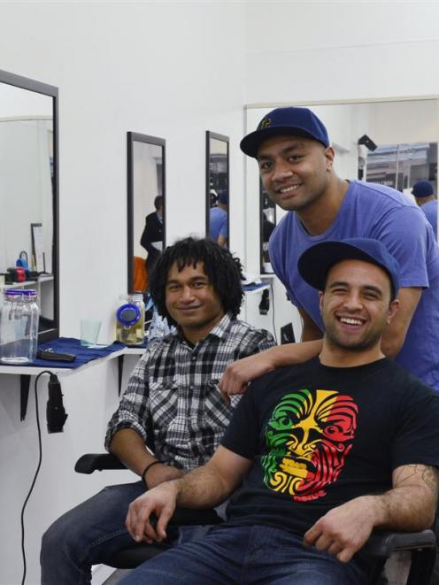 The new owners of Fresh Crew Barbers, from left, Mase Makabaha (29), Vea Fonua (29) and Joel...