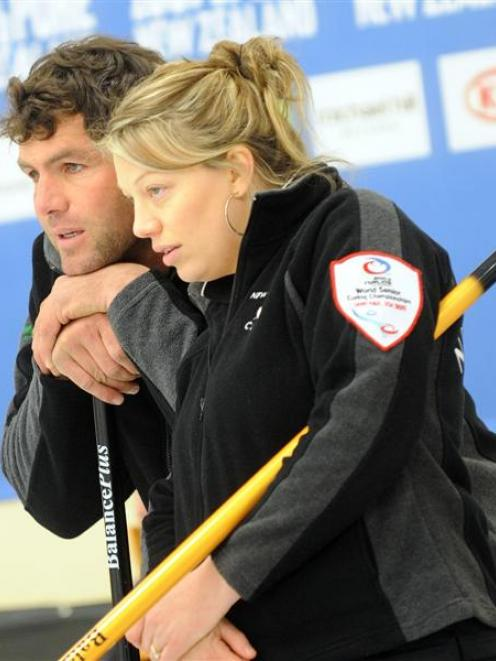 The New Zealand mixed doubles pair of Sean  and Bridget Becker examine the head in the mixed...