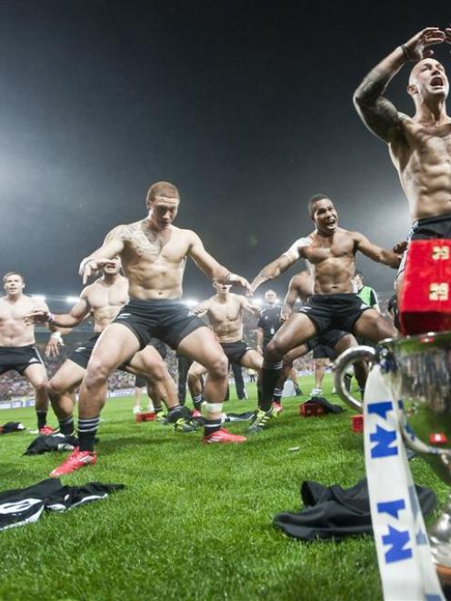 The New Zealand team does the haka to celebrate winning the final of the 2011 Wellington Sevens...