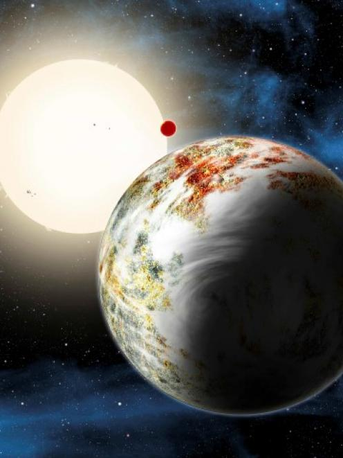 The newly discovered 'mega-Earth' Kepler-10c dominates the foreground in this artist's conception...