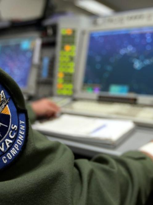 The patch of the NATO AWACS (Airborne Warning and Control Systems) aircraft is seen attached to...