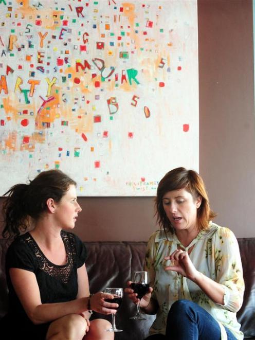 The Perc cafe owner Sarah Henderson (left) and Zaibatsu Hair Art owner Jaimee Smith discuss their...