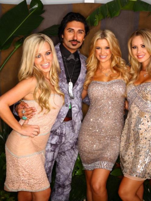 The playmates with NZ celebrity Colin Mathura-Jeffree at the party. Photo Hallensteins