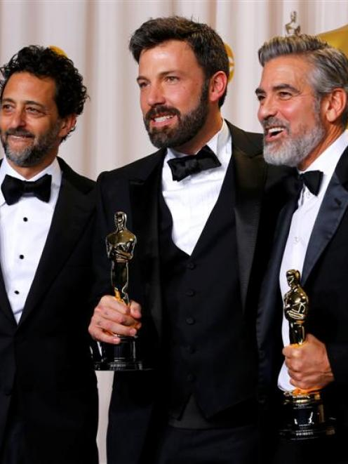 """The producers of """"Argo, the winner for best picture, Grant Heslov, Ben Affleck and George Clooney..."""