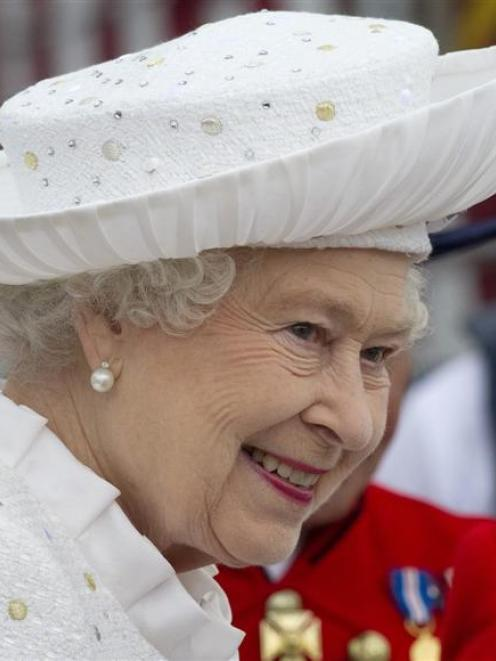 The Queen before embarking at Chelsea Wharf yesterday to travel down the Thames at the centre of...