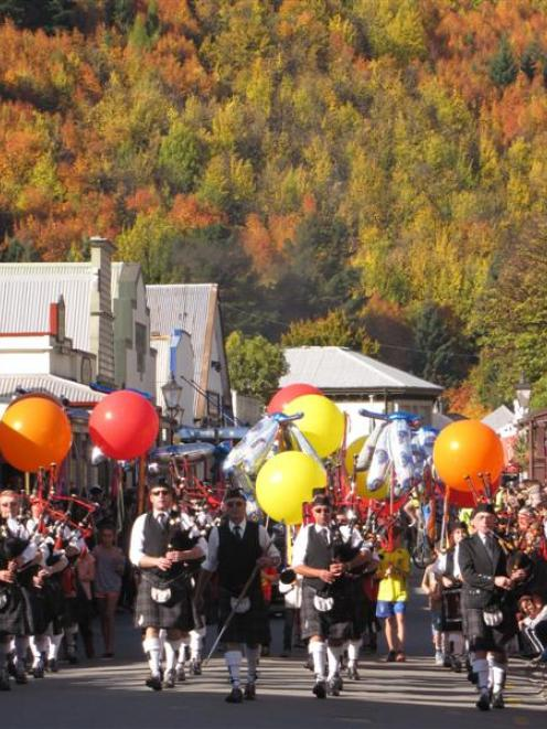 The Queenstown and Southern Lakes Pipe Band leads the Arrowtown Autumn Festival street parade on...