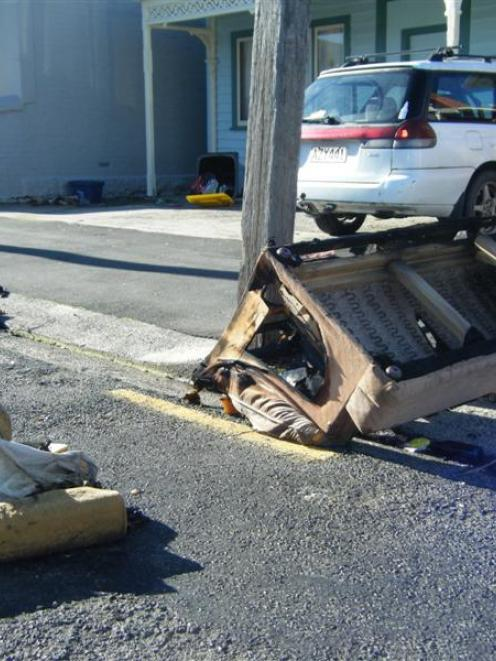 The remains of a burnt couch in Castle St North yesterday. It was one of several furniture fires...