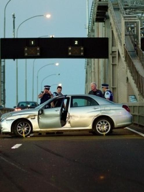 The scene on Auckland Harbour Bridge after a shooting incident and a police car chase. Photo /...
