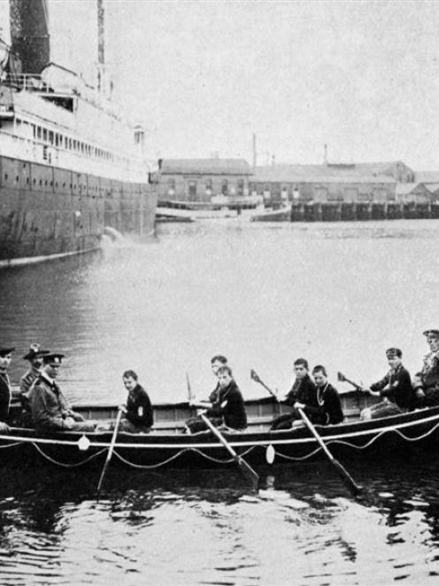 The Sea Scouts' new boat Foam Queen near the Dunedin wharf, with the first crew of Sea Scouts in...