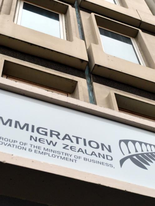 The sign above the Immigration New Zealand offices in Bond Street, Dunedin. Photo by Gerard O'Brien.
