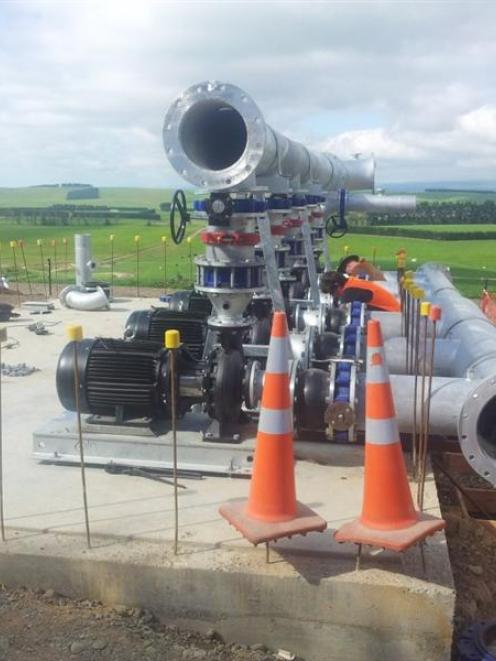 The six pumps with suction and discharge pipes before the pump house was built on the expanded...