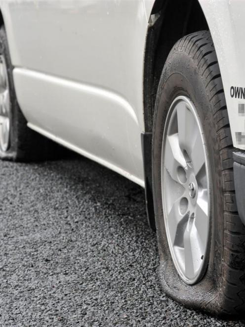 The slashed tyres of an Airport Shuttles Dunedin van could indicate a malicious rivalry within...
