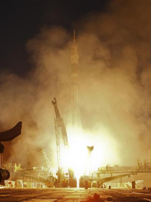 The Soyuz TMA-07M spacecraft blasts off from its launch pad at the Baikonur cosmodrome. REUTERS...