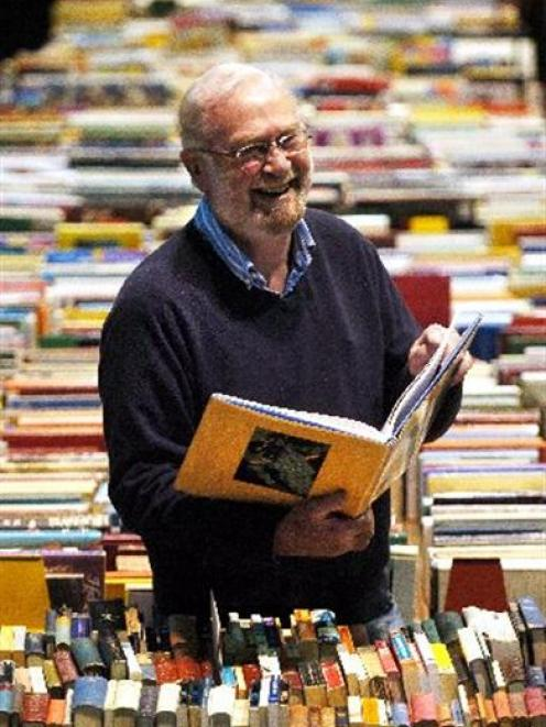The Star Regent 24-hour Book Sale convener Doug Lovell enjoys browsing through a selection of...