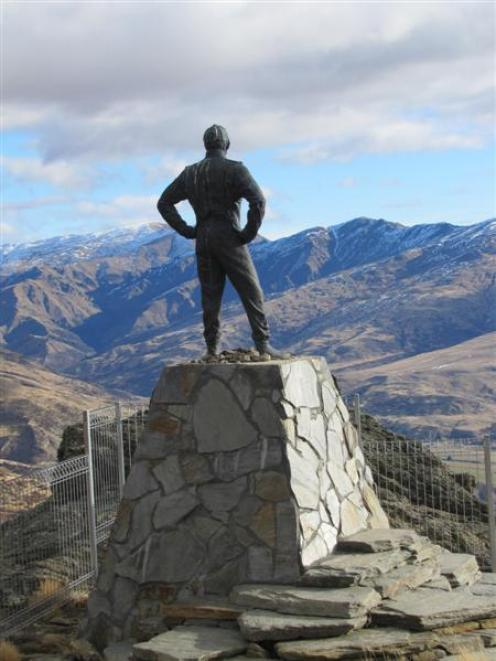The  statue of rally driver Possum Bourne looks over the Cardrona Valley,  about 9km up the Snow...