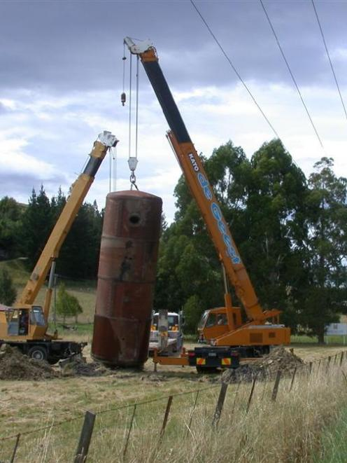 The Steampunk tank is hoisted into place. Photo by David Bruce.