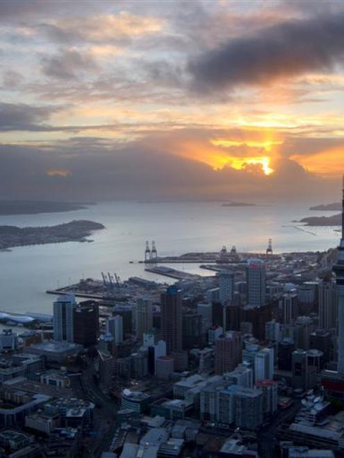 The sun rises over Auckland city. Photo by the New Zealand Herald.