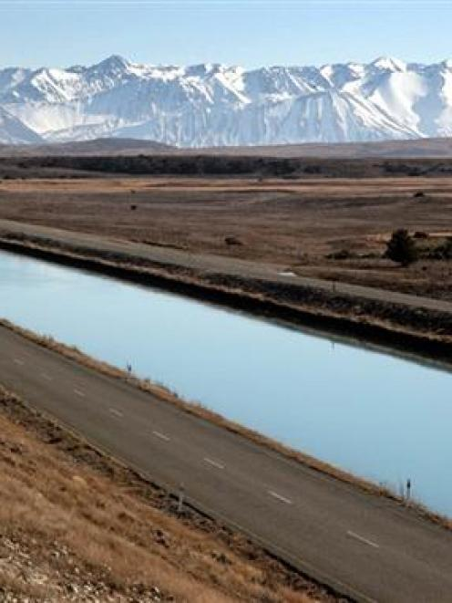 The Tekapo canal, with the Southern Alps in the background. Photo by Genesis.