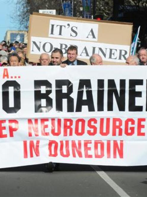 The thousands of people taking part in the Keep Neurosurgery in Dunedin march yesterday move down...