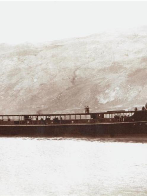 The TSS <i>Earnslaw</i> hull cruises on Lake Wakatipu in 1912 on its way to Queenstown.  The hull...