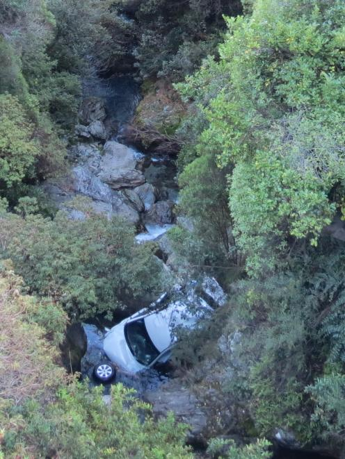 The vehicle came to rest on the rocks of Wye Creek, more than 20m below the 30km hairpin bend on...