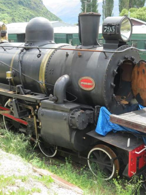 The vintage  steam locomotive AB795 (above) and its sister  AB778 sit exposed to the elements  in...