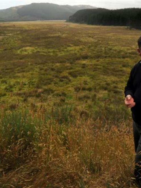 The wetland area behind Otago Fish and Game Council operations manager Ian Hadland should be...