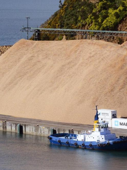 The woodchip pile at Port Chalmers, most of which left this week for China, with Port Otago's tug...