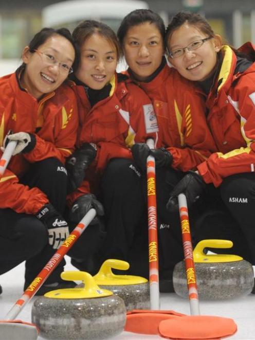 The world champion Chinese women's team (from left) Yan Zhou, Qingshuang Yue, Yin Liu and skip...