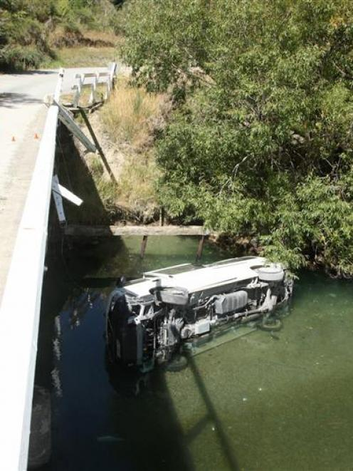 This van which carried a  family group of 10 lies in the Mataura River after crashing off Nokomai...