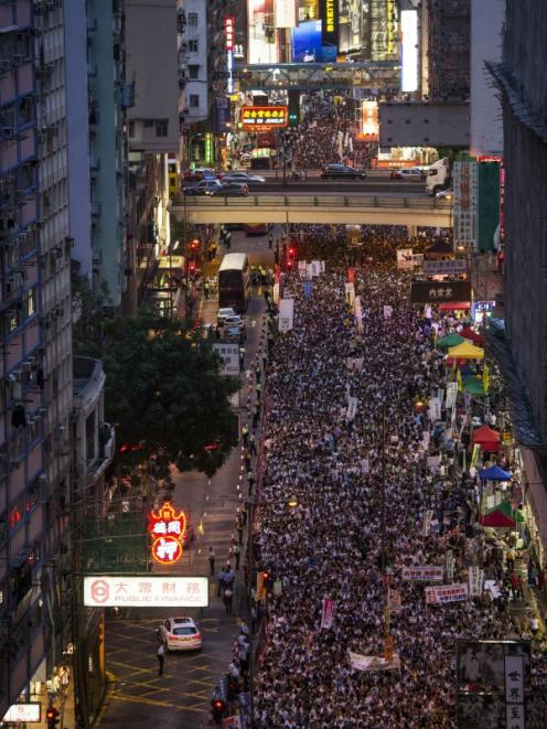Thousands of pro-democracy protesters gather to march in the streets to demand universal suffrage...