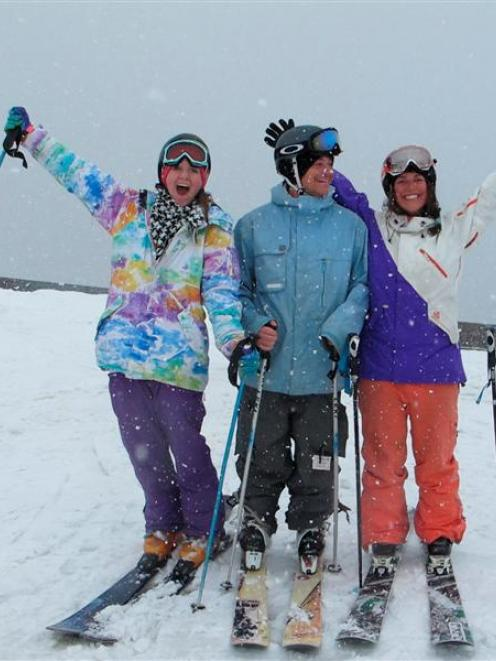 Three happy skiers welcome snow at the Treble Cone skifield on Saturday. From left are Kirsty...