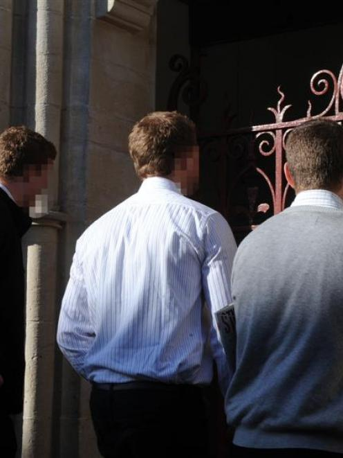 Three men charged following the Undie 500 disorder enter the Dunedin District Court yesterday....
