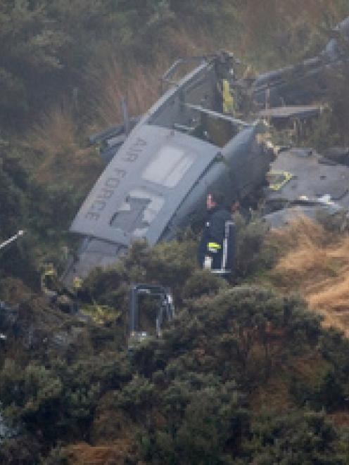 Three men died and one was seriously injured when the RNZAF Iroquois helicopter crashed near...