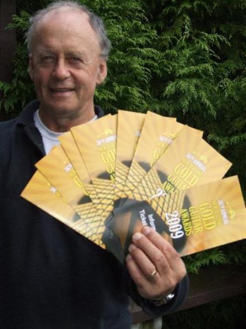 New Zealand Gold Guitar Awards convener Phil Geary with the newly printed programmes for the event.