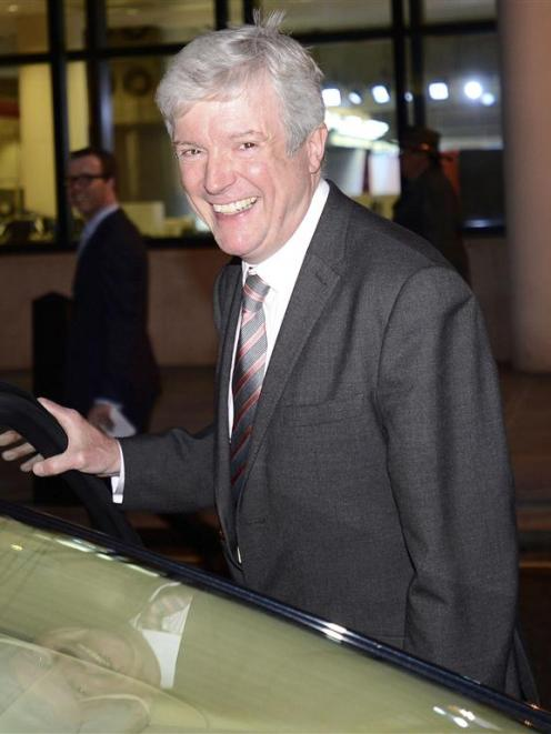 Tony Hall, who has been appointed director general of the BBC, smiles as he leaves New...