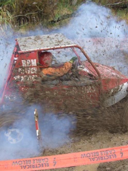 Tony Richardson negotiates a hazard during the Rotary Club of Waitaki's four-wheel-drive mud-plug...