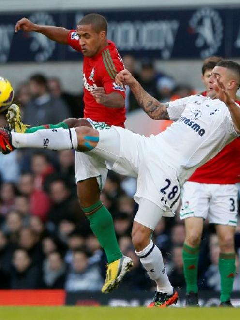 Tottenham Hotspur's Kyle Walker (R) challenges Swansea's Wayne Routledge during their English...