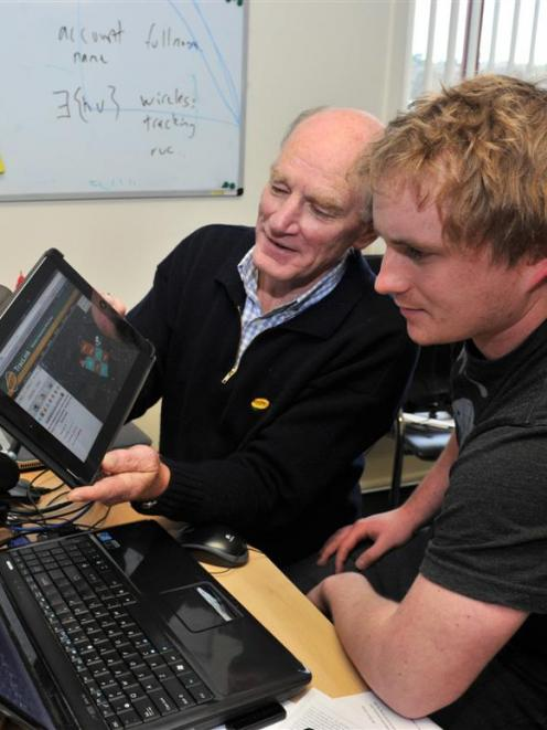 TracMap founder Colin Brown (left) and developer Joshua Gagnon with the company's TracLink ...