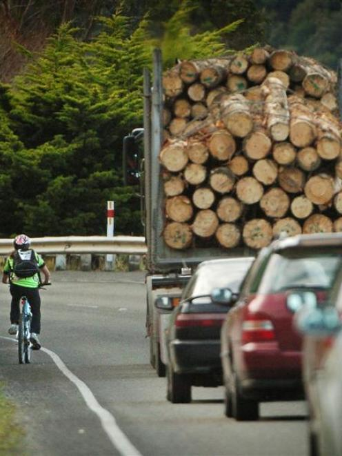 Traffic passes a cyclist on State Highway 88 near Blanket Bay yesterday afternoon. Photo by...