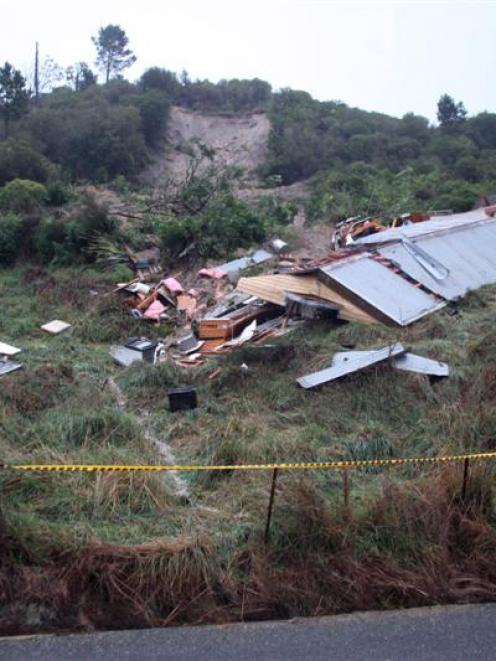 Tragedy ... The wrecked house where a woman was killed yesterday afternoon after a landslip at...