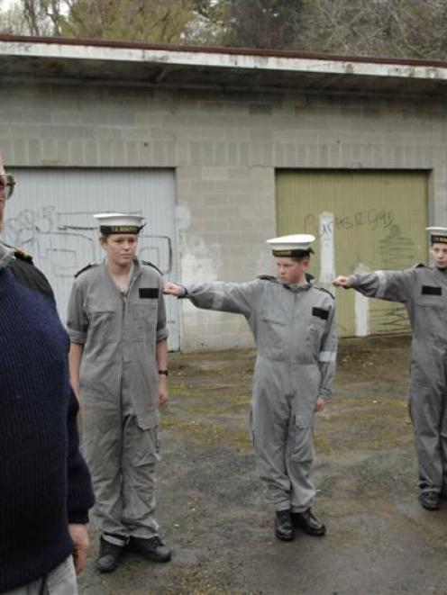 Training ship TS Nimrod Lieutenant-commander Brian Elder with (from left) leading cadet William...