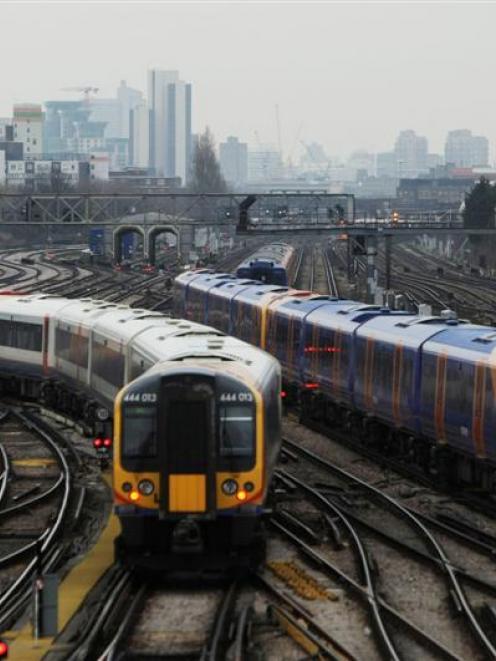 Trains seen from Clapham Junction station in London. Photo Matt Dunham/AP.