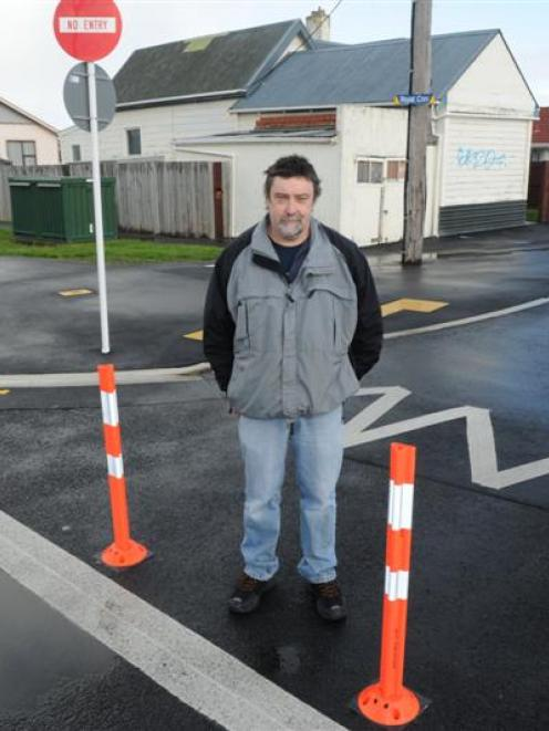 Trevor McStay with new bollards installed on the street. Photo by Craig Baxter.