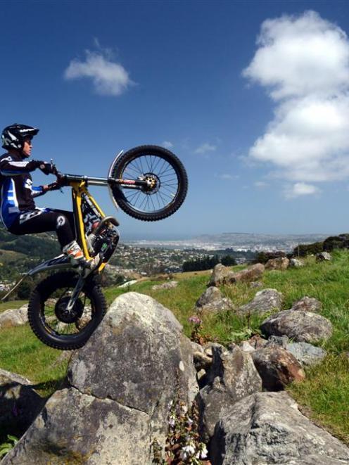 Trials rider Blake Fox (19) gets in some rock-hopping practice in Northeast Valley last week....